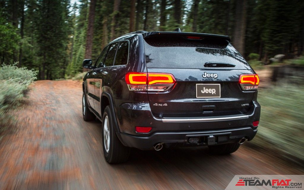 2014-Jeep-Grand-Cherokee-Limited-left-rear-1.jpg
