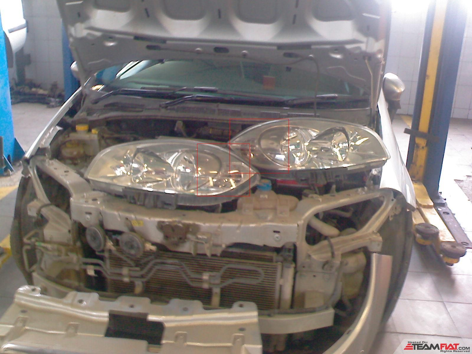Headlamps being changed.JPG